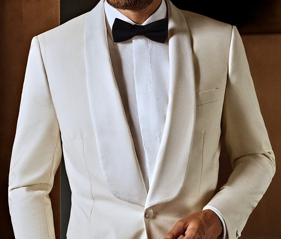 Sleek white custom made tuxedo, perfect for black tie occasions and tailored to the individual