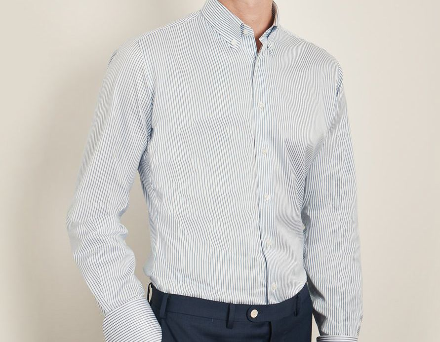 Smart pinstripe men's work shirt, custom made by Senszio travelling tailors to suit lifestyle and frame