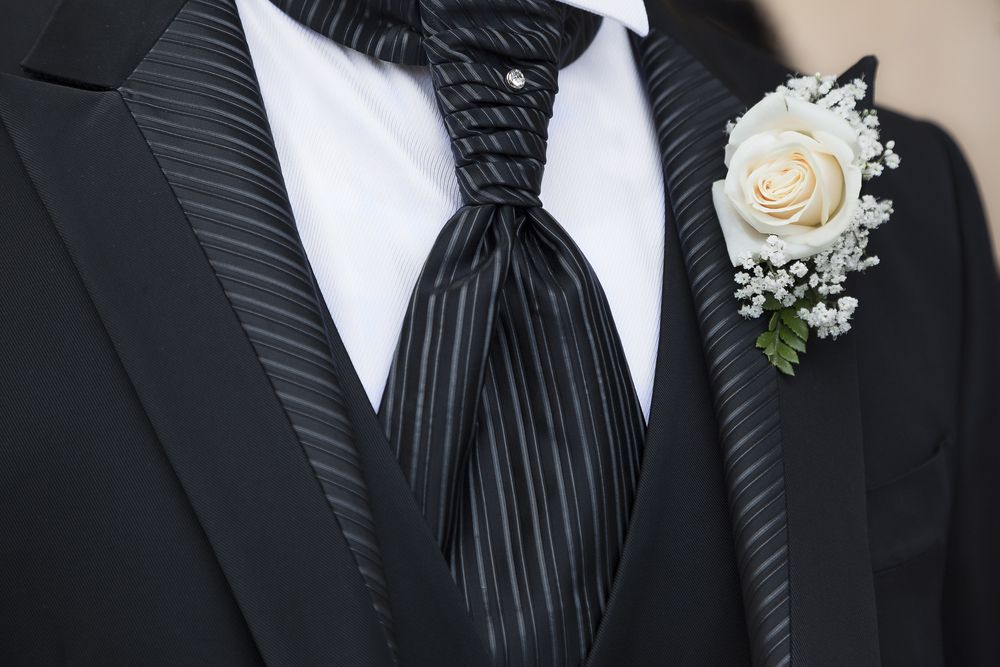 Boutonnière And A Diamond Stud On A Striped Tie