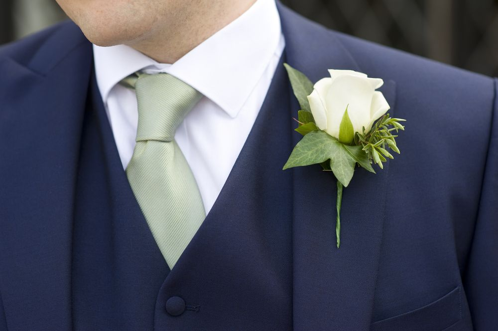 Boutonnière On A Three Piece Blue Suit