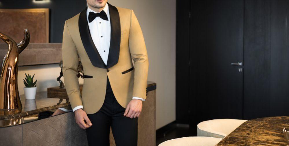 Black Bow Tie On A Tortilla Tuxedo Jacket With Black Tuxedo Pants