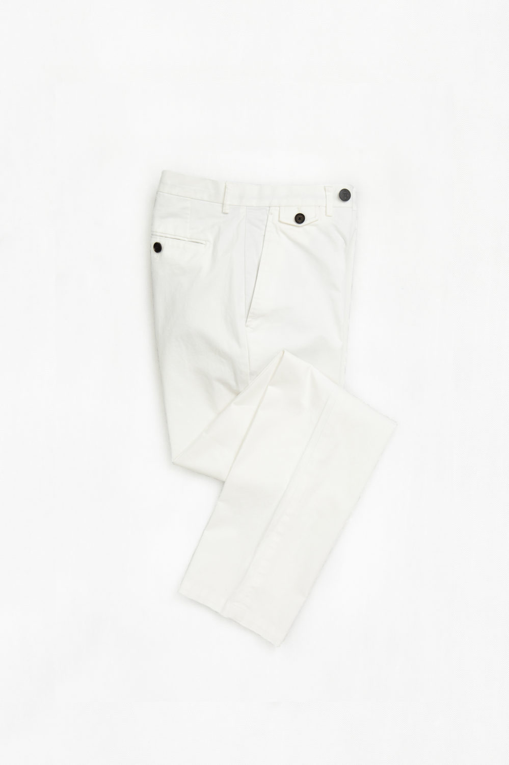 Flat lay of white chinos, custom tailored by Senszio to each individual's size and preferences