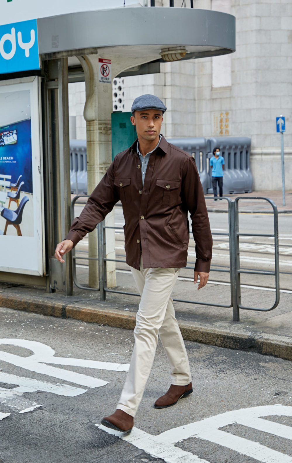 Male model wearing stylish brown shirt jacket with cream chinos and a grey polo, part of Senszio's casualwear range