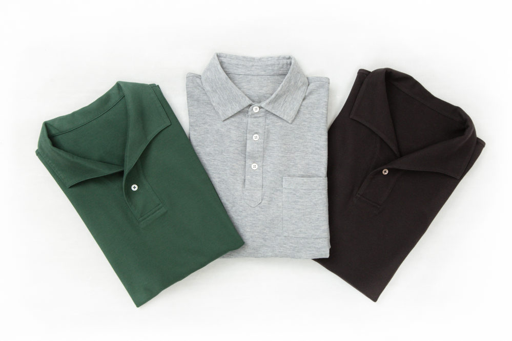 Flat lays of Senszio custom made polo shirts, in green, grey and black. Made from premium Italian stretch cotton