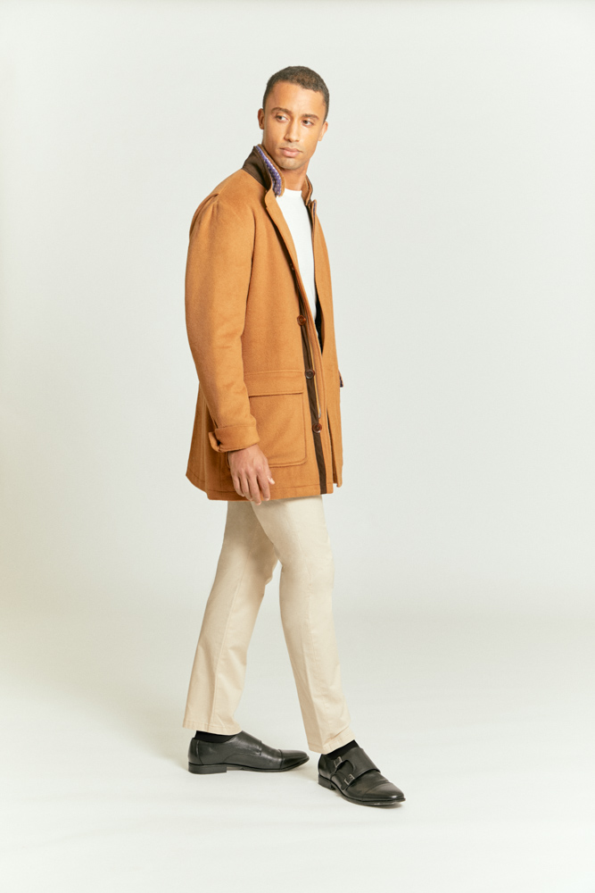 Tailored cream chinos partnered with a stylish light brown coat, styled and custom made by Senszio