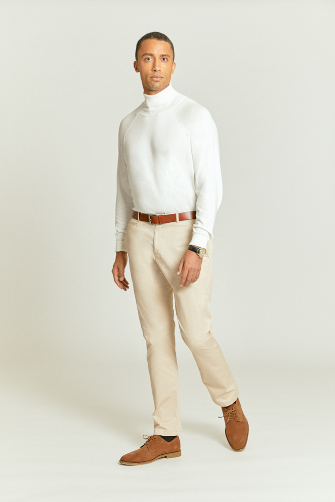 Stylish cream chinos combined with brown shoes, brown belt and white rollneck jumper for a timeless and comfortable look