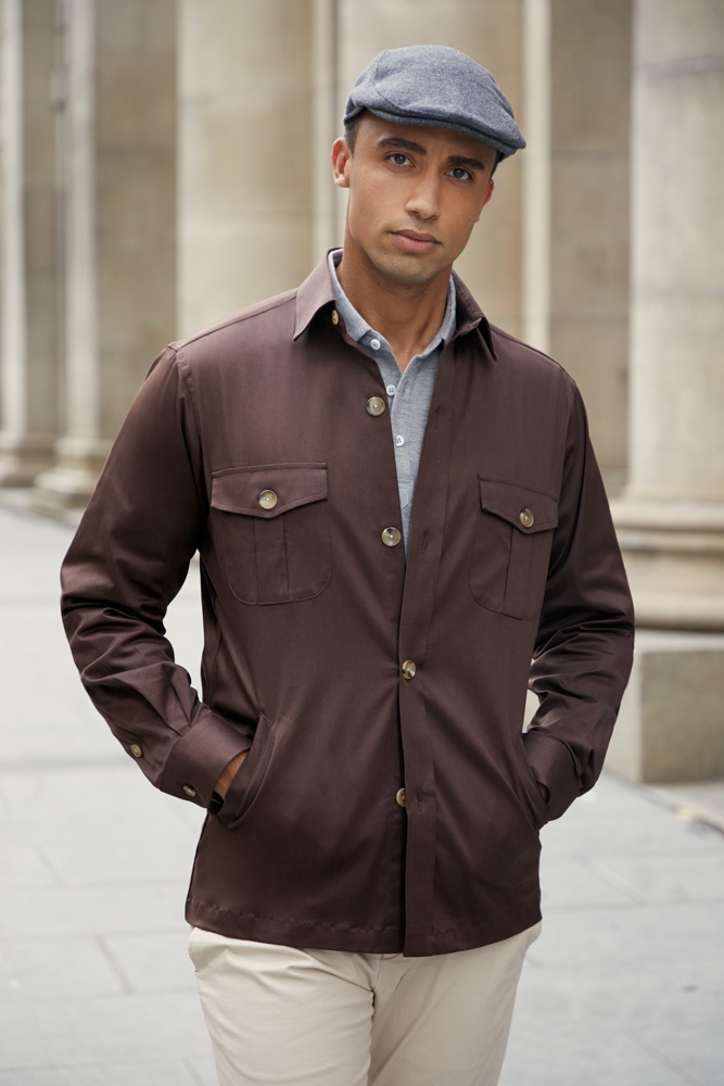 Stylish light grey polo shirt worn under a brown overshirt, custom made by Senszio