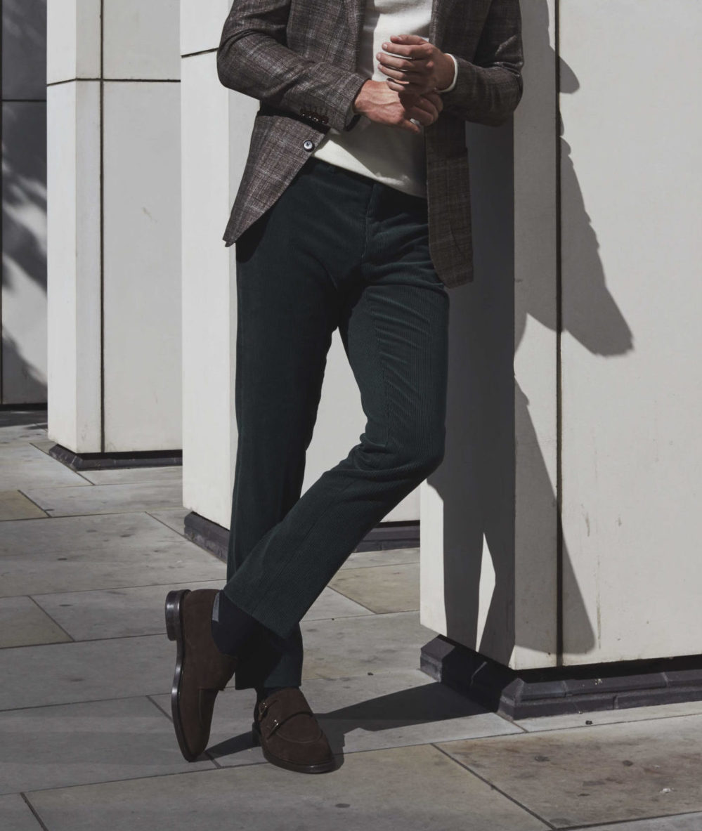 Model in green corduroy chinos, part of Senszio's expertly tailored casualwear range for men