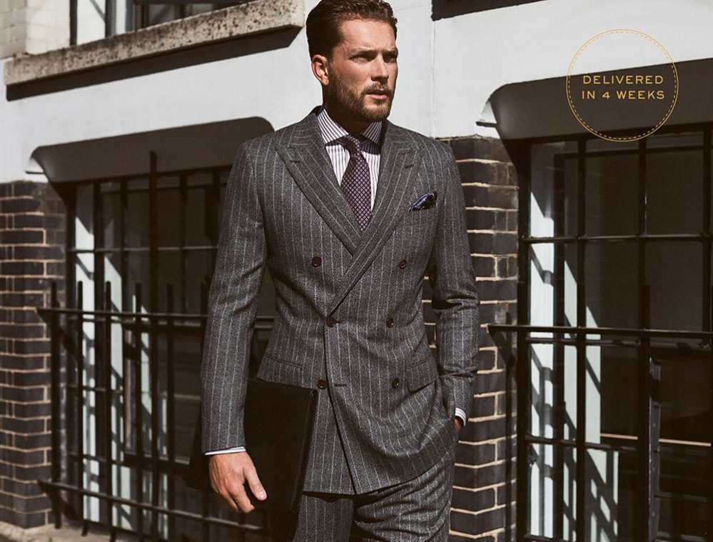 Man in pinstripe smart suit, custom made by Senszio and available for worldwide delivery within 4 weeks